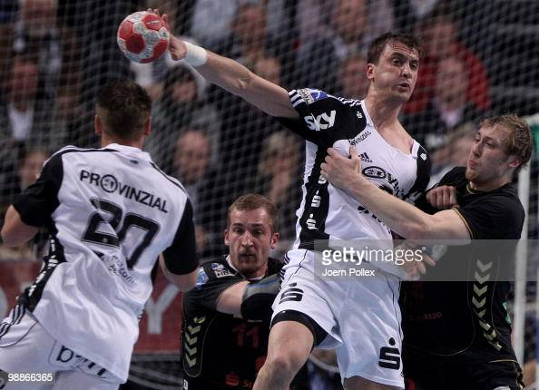 Momir Ilic of Kiel battles for the ball with Maximilian Weiss and Patrick Foelser of Duesseldorf during the Toyota Handball Bundesliga match between...