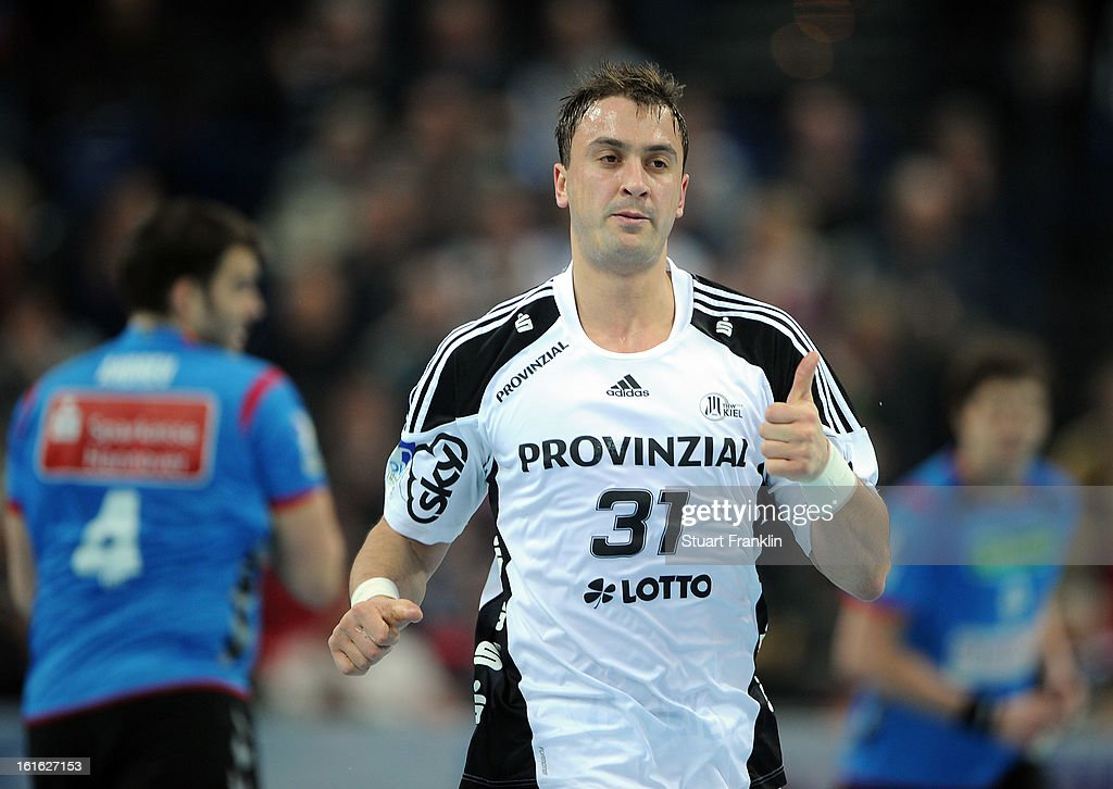 Momir Ilic of Kiel celebrates a goal during the HBL Bundesliga game between THW Kiel and TSV Hannover-Burgdorf at the Sparkassen arena on February 13, 2013 in Kiel, Germany.