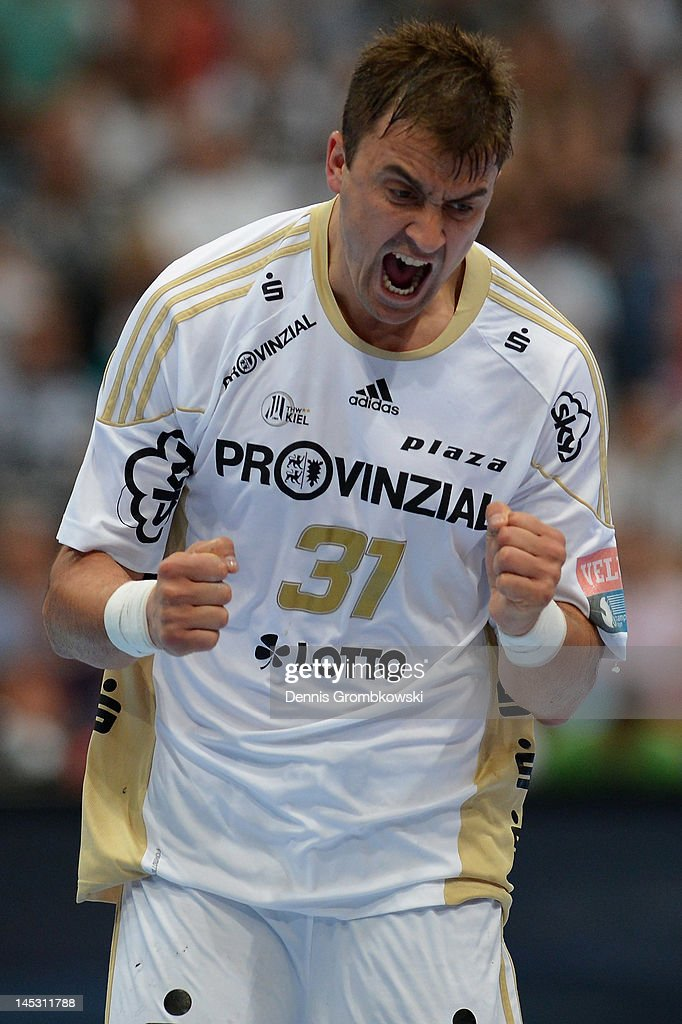 <a gi-track='captionPersonalityLinkClicked' href=/galleries/search?phrase=Momir+Ilic&family=editorial&specificpeople=857763 ng-click='$event.stopPropagation()'>Momir Ilic</a> of Kiel celebrates after scoring during the EHF Final Four semi final match between Fuechse Berlin and THW Kiel at Lanxess Arena on May 26, 2012 in Cologne, Germany.