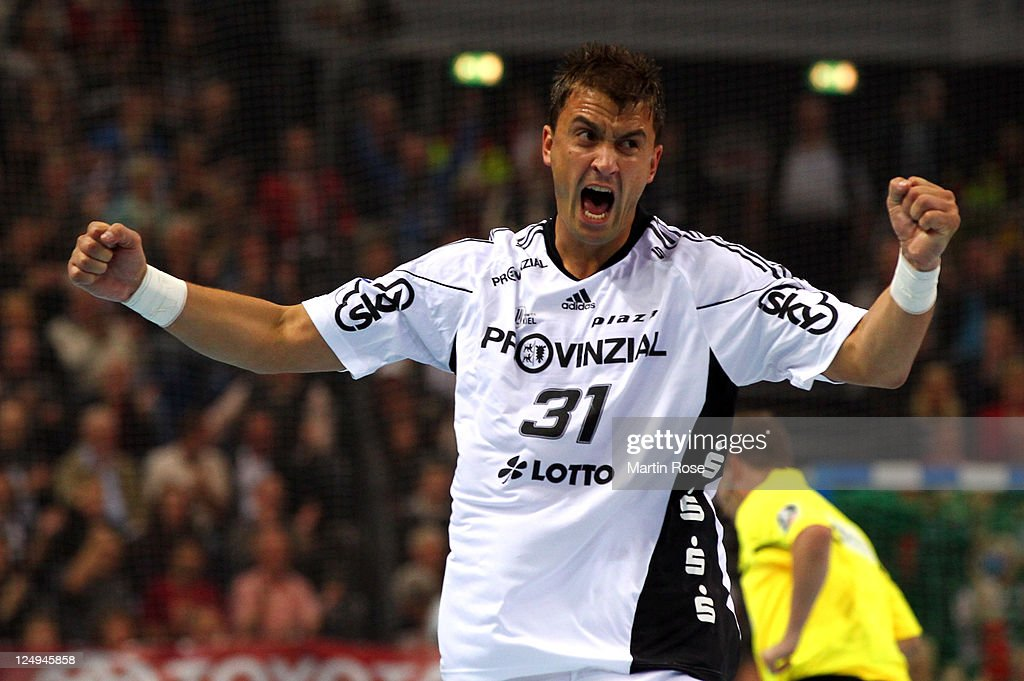<a gi-track='captionPersonalityLinkClicked' href=/galleries/search?phrase=Momir+Ilic&family=editorial&specificpeople=857763 ng-click='$event.stopPropagation()'>Momir Ilic</a> of Kiel celebrates after scoring during the Toyota Handball Bundesliga match between THW Kiel and Frisch Auf Goeppingen at the Sparkassen Arena on September 14, 2011 in Kiel, Germany.