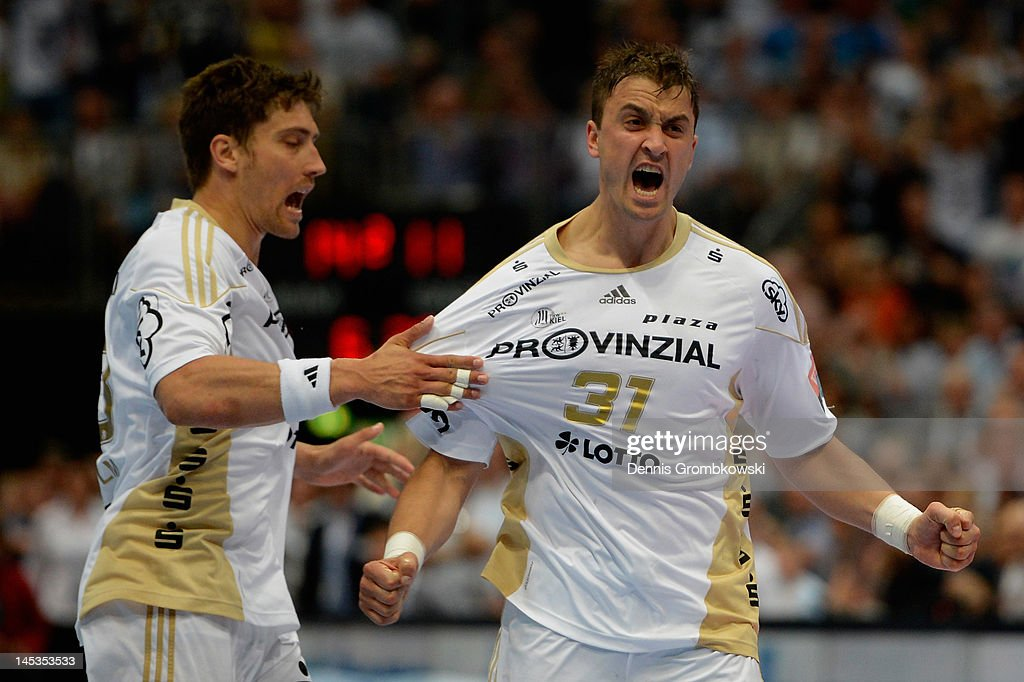 Momir Ilic of Kiel celebrates with teammate Marcus Ahlm after scoring during the EHF Final Four final match between THW Kiel and BM Atletico Madrid at Lanxess Arena on May 27, 2012 in Cologne, Germany.