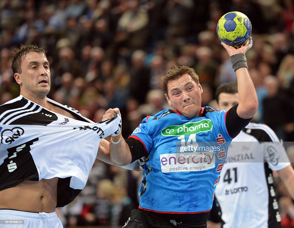 Momir Ilic of Kiel challenges for the ball with Joakim Andre Hykkerud of Hannover during the HBL Bundesliga game between THW Kiel and TSV Hannover-Burgdorf at the Sparkassen arena on February 13, 2013 in Kiel, Germany.