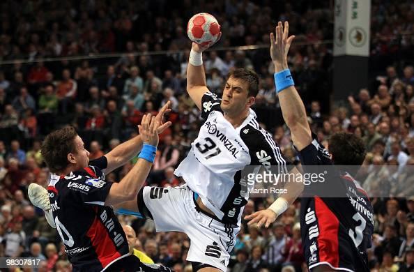 Momir Ilic of Kiel challenges Tobias Karlsson and Thomas Mogensen of FlensburgHandewitt for the ball during the Toyota Handball Bundesliga match...
