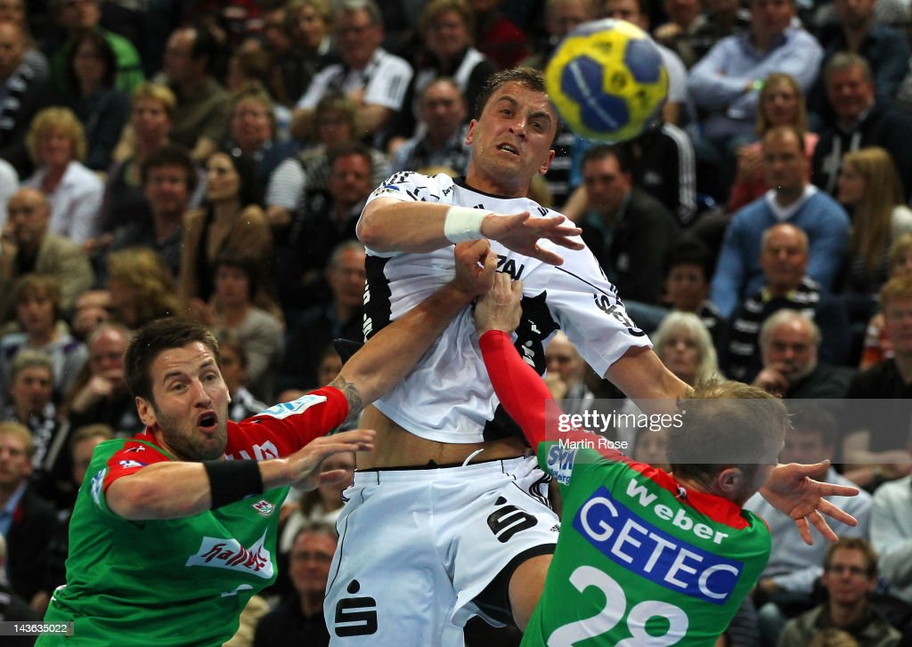 Momir Ilic (C) of Kiel challens Bennet Wiegert (L) and Robert Weber (R) of Magdeburg during the Toyota Handball Bundesliga match between THW Kiel and SC Magdeburg at Sparkassen Arena on May 1, 2012 in Kiel, Germany.