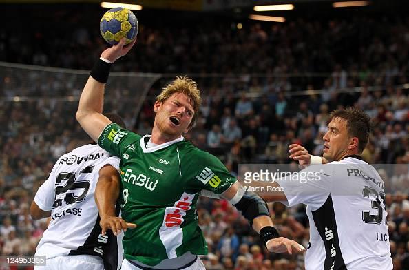 Momir Ilic of Kiel challens Manuel Spaeth of Goeppingen during the Toyota Handball Bundesliga match between THW Kiel and Frisch Auf Goeppingen at the...