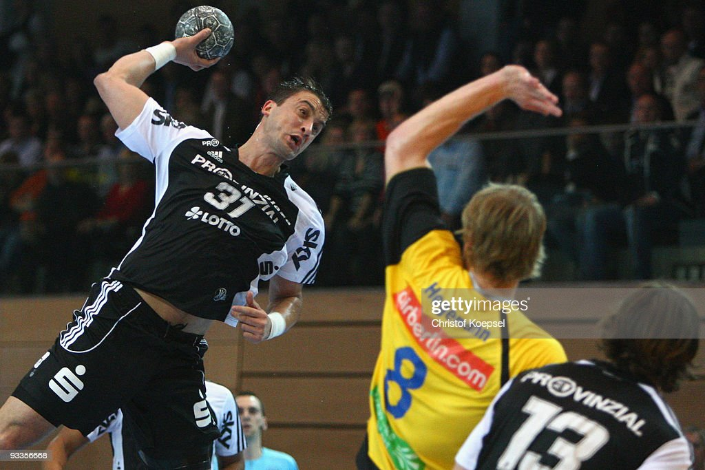 Momir Ilic of Kiel scores a goal against Michael Hegemann of Duesseldorf during the Toyota Handball Bundesliga match between HSG Duesseldorf and THW...