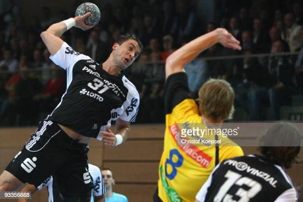 Momir Ilic of Kiel scores a goal against Michael Hegemann of Duesseldorf during the Toyota Handball Bundesliga match between HSG Duesseldorf and THW...