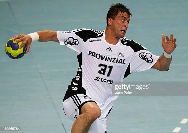 Momir Ilic of Kiel scores during the DKB Handball Bundesliga match between THW Kiel and HSG Wetzlar at SparkassenArena on June 5 2013 in Kiel Germany