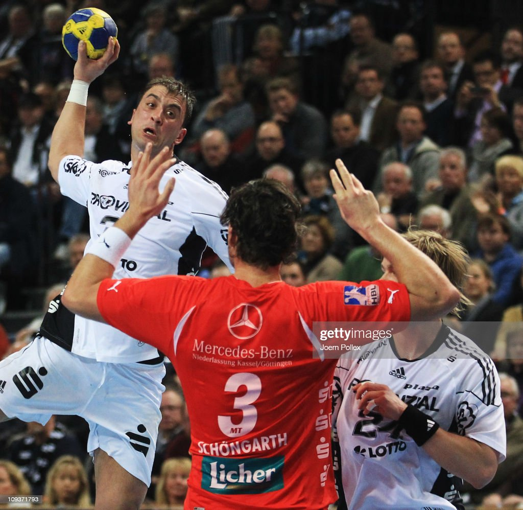 <a gi-track='captionPersonalityLinkClicked' href=/galleries/search?phrase=Momir+Ilic&family=editorial&specificpeople=857763 ng-click='$event.stopPropagation()'>Momir Ilic</a> of Kiel scores during the Toyota Handball Bundesliga match between THW Kiel and MT Melsungen at the Sparkassen Arena on February 23, 2011 in Kiel, Germany.