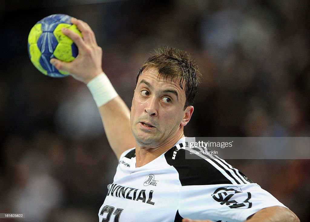 Momir Ilic of Kiel throws a goal during the HBL Bundesliga game between THW Kiel and TSV Hannover-Burgdorf at the Sparkassen arena on February 13, 2013 in Kiel, Germany.