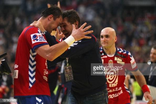 Momir Ilic of Serbia and head coach Veselin Vukovic of Serbia celebrate the 2622 victory after the Men's European Handball Championship second semi...