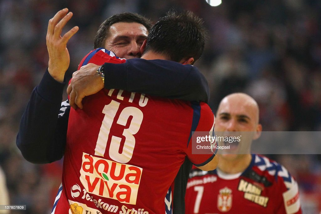 Momir Ilic of Serbia and head coach Veselin Vukovic of Serbia celebrate the 2622 victory after the Men's European Handball Championship second semi...