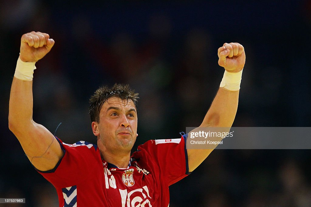 <a gi-track='captionPersonalityLinkClicked' href=/galleries/search?phrase=Momir+Ilic&family=editorial&specificpeople=857763 ng-click='$event.stopPropagation()'>Momir Ilic</a> of Serbia celebrates a goal during the Men's European Handball Championship second round group one match between Serbia anhd Germany at Beogradska Arena on January 21, 2012 in Belgrade, Serbia.
