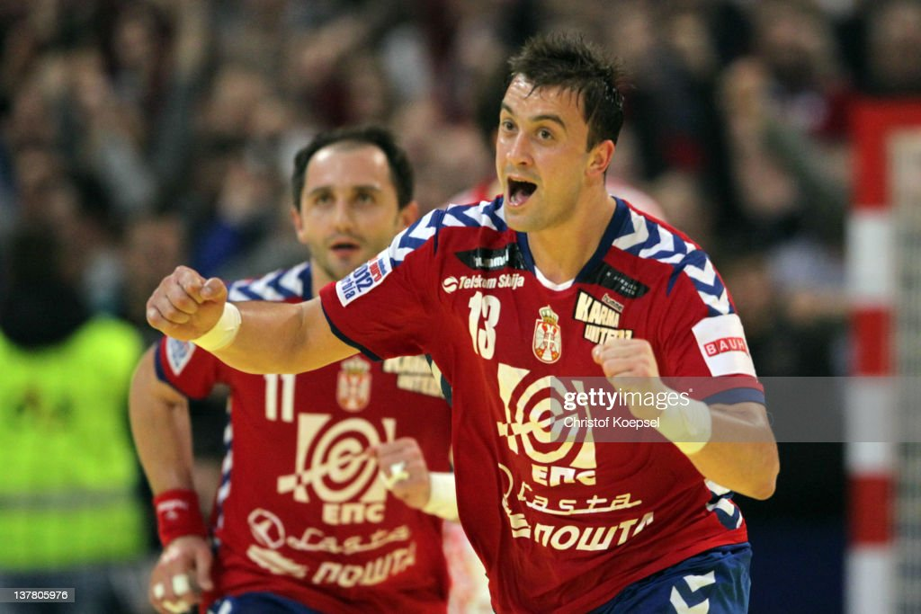 <a gi-track='captionPersonalityLinkClicked' href=/galleries/search?phrase=Momir+Ilic&family=editorial&specificpeople=857763 ng-click='$event.stopPropagation()'>Momir Ilic</a> of Serbia celebrates a goal during the Men's European Handball Championship second semi final match between Serbia and Croatia at Beogradska Arena on January 27, 2012 in Belgrade, Serbia.