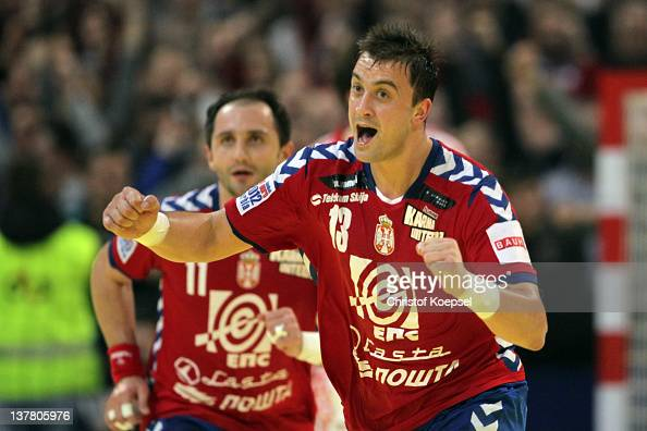 Momir Ilic of Serbia celebrates a goal during the Men's European Handball Championship second semi final match between Serbia and Croatia at...