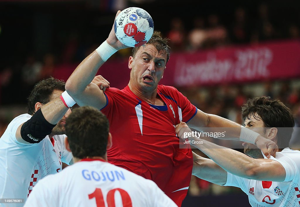 Momir Ilic of Serbia is challenged by Croatia defenders during the Men's Handball Preliminary match between Serbia and Croatia on Day 4 of the London 2012 Olympic Games at The Copper Box on July 31, 2012 in London, England.