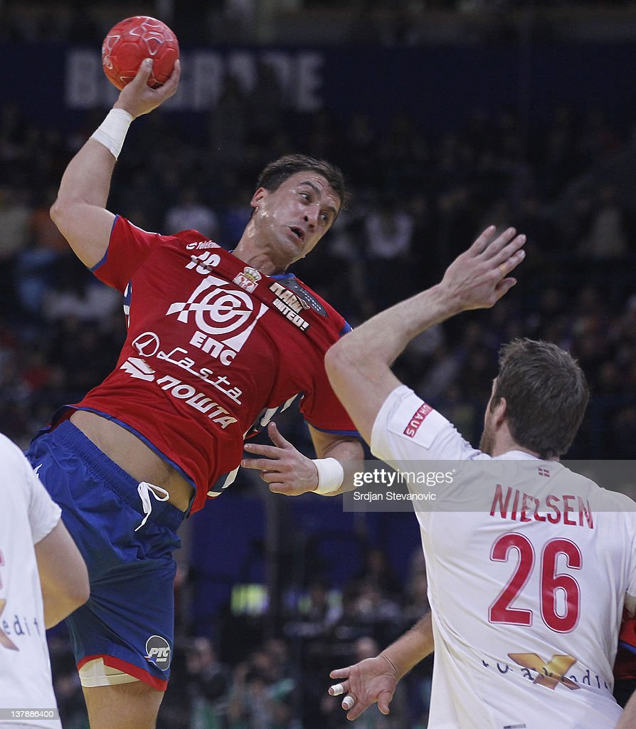 Momir Ilic of Serbia jumps to score past Kasper Nilsen of Denmark during the Men's European Handball Championship 2012 final match between Serbia and...