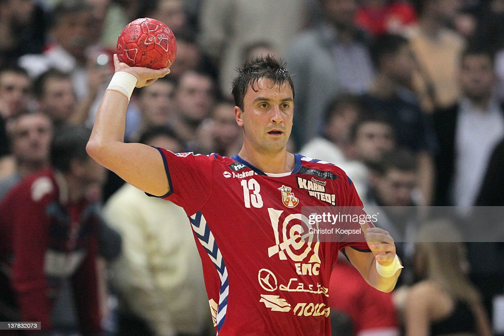 Momir Ilic of Serbia passes the ball during the Men's European Handball Championship second semi final match between Serbia and Croatia at Beogradska...
