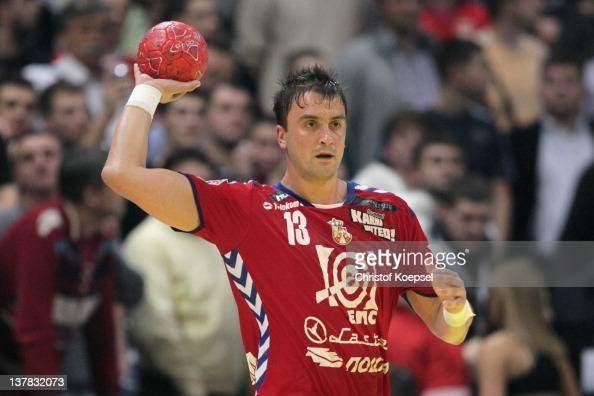 Momir Ilic of Serbia passes the ball during the Men's European Handball Championship second semi final match between Serbia and Croatia at Beogradska...
