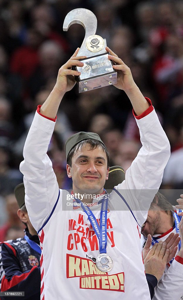 <a gi-track='captionPersonalityLinkClicked' href=/galleries/search?phrase=Momir+Ilic&family=editorial&specificpeople=857763 ng-click='$event.stopPropagation()'>Momir Ilic</a> of Serbia poses with the trophy for the second place on the podium after losing 19-21 the Men's European Handball Championship final match between Serbia and Denmark at Beogradska Arena on January 29, 2012 in Belgrade, Serbia.