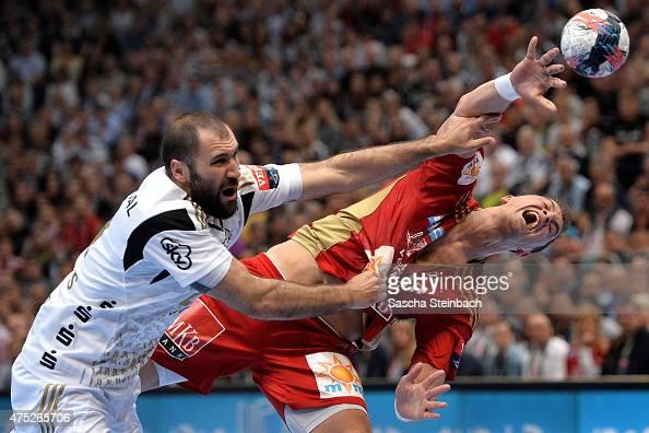Momir Ilic of Veszprem and Joan Canellas Reicach of Kiel battle for the ball during the 'VELUX EHF FINAL4' semi final match between THW Kiel v MKBMVM...