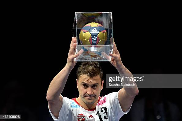 Momir Ilic of Veszprem celebrates with the trophy as best scorer of the season after losing the 'VELUX EHF FINAL4' final match against FC Barcelona...