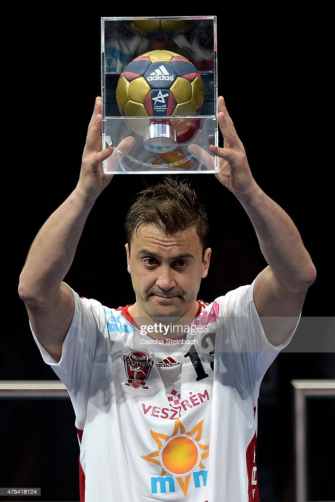 <a gi-track='captionPersonalityLinkClicked' href=/galleries/search?phrase=Momir+Ilic&family=editorial&specificpeople=857763 ng-click='$event.stopPropagation()'>Momir Ilic</a> of Veszprem celebrates with the trophy as best scorer of the season after losing the 'VELUX EHF FINAL4' final match against FC Barcelona at Lanxess Arena on May 31, 2015 in Cologne, Germany.