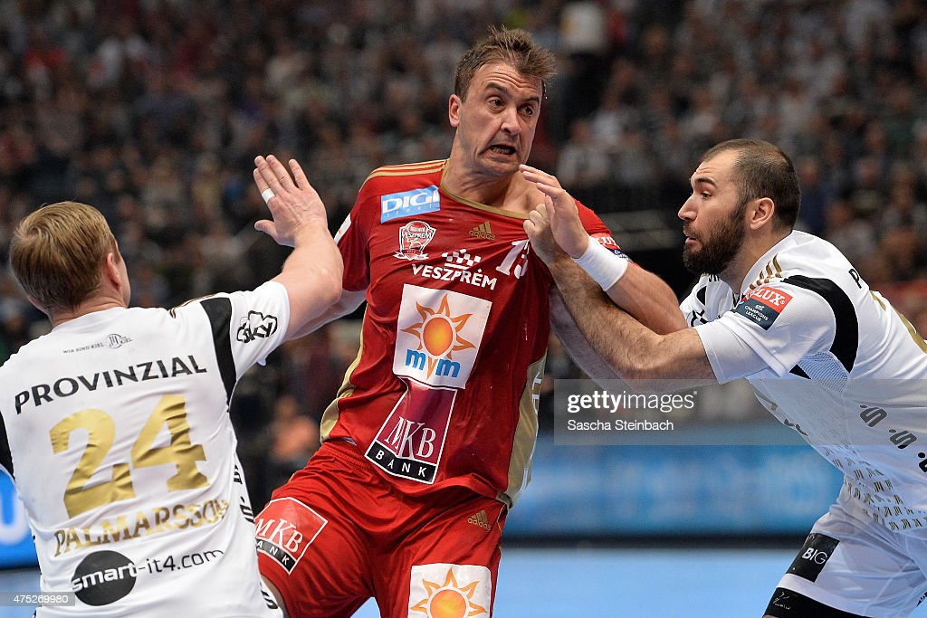 Momir Ilic of Veszprem is challenged by Aron Palmarsson and Joan Canellas Reicach of Kiel during the 'VELUX EHF FINAL4' semi final match between THW...