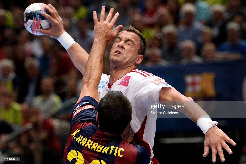 <a gi-track='captionPersonalityLinkClicked' href=/galleries/search?phrase=Momir+Ilic&family=editorial&specificpeople=857763 ng-click='$event.stopPropagation()'>Momir Ilic</a> of Veszprem is challenged by <a gi-track='captionPersonalityLinkClicked' href=/galleries/search?phrase=Nikola+Karabatic&family=editorial&specificpeople=620415 ng-click='$event.stopPropagation()'>Nikola Karabatic</a> of Barcelona during the 'VELUX EHF FINAL4' final match between FC Barcelona and MKB-MVM Veszprem at Lanxess Arena on May 31, 2015 in Cologne, Germany.