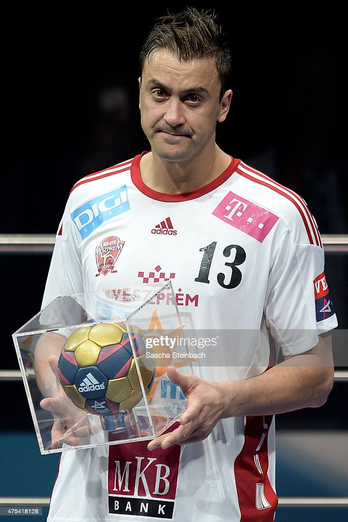 Momir Ilic of Veszprem poses with the trophy as best scorer of the season after losing the 'VELUX EHF FINAL4' final match against FC Barcelona at...