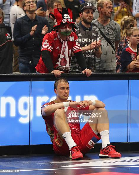 Momir Ilic of Veszprem sits in front of a supporter after losing the EHF Champions League Final against KS Vive Tauron Kielce on May 29 2016 in...