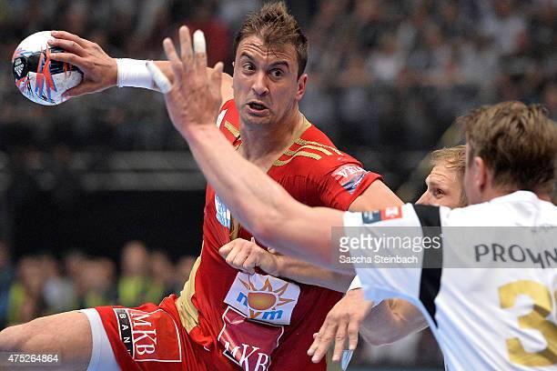 Momir Ilic of Veszprem throws the ball during the 'VELUX EHF FINAL4' semi final match between THW Kiel v MKBMVM Veszprem at Lanxess Arena on May 30...