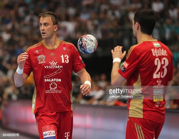 Momir Ilic of Veszprem throws the ball to Cristian Garcia Ugalde during the second semifinal of the EHF Final4 between THW Kiel and MVM Veszprem on...