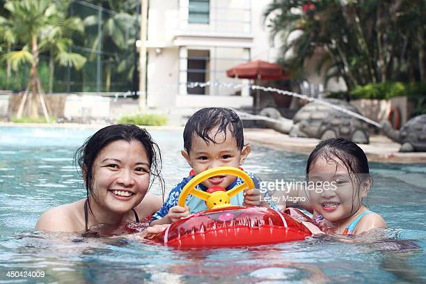 Mommy with daughter and son swimming