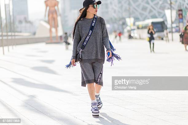 Momo Zhai wearing a cap grey sweater with fringes and skirt on October 20 2016 in Seoul South Korea