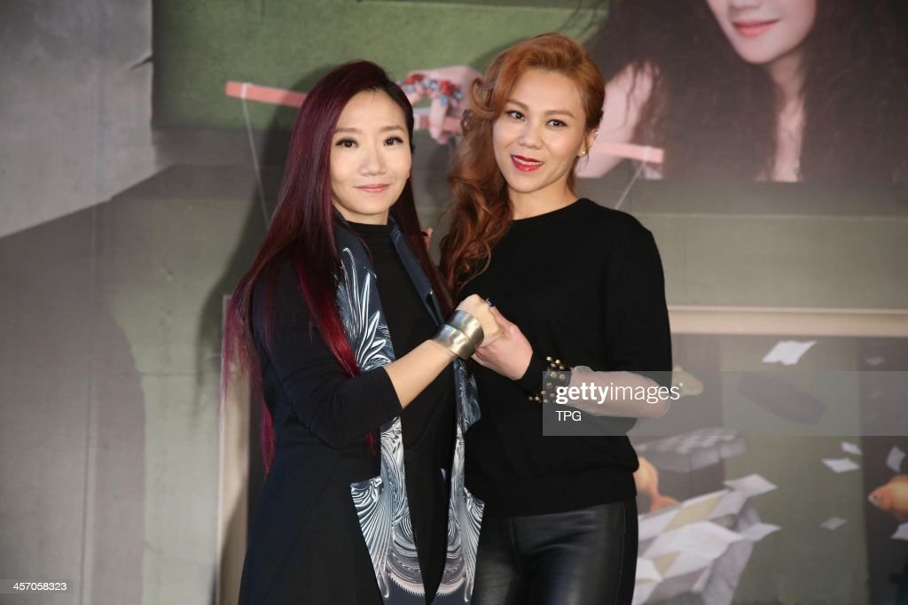 Momoco Tao promotes her new album on Sunday December 15,2013 in Taipei,China.Tanya Chua presents to support.