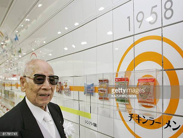Momofuku Ando founder of Japan's Nissin Food Products Co poses next to a package of company's historic first bag of chicken ramen which was...