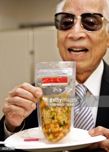 Momofuku Ando Nissin food products chairman and popularly known as maker of instant noodles displays the instant noodles for astronauts called 'Space...