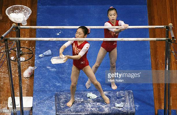 Momoko Ozawa and Mai Yamagashi of Japan chalk the uneven bars during the artistic Gymnastics competition of the Australian Youth Olympic Festival at...