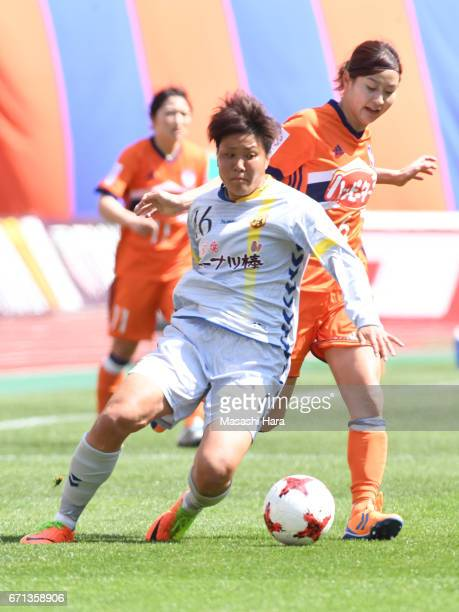 Momoko Sayama of Albirex Nigata and Ayaka Michigami of INAC Kobe Leonessa compete for the ball during the Nadeshiko League match between Albirex...