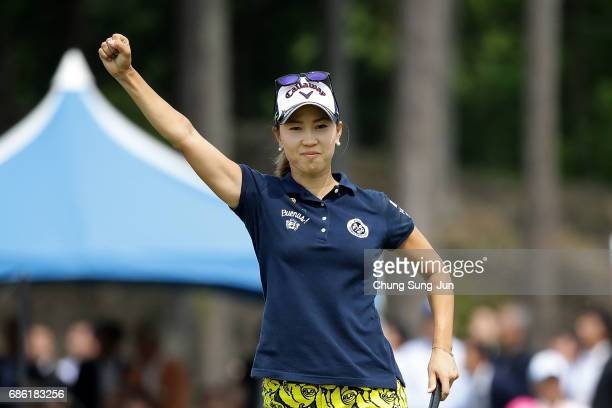 Momoko Ueda of Japan celebrates after a winning putt on the 18th green during the final round of the Chukyo Television Bridgestone Ladies Open at the...
