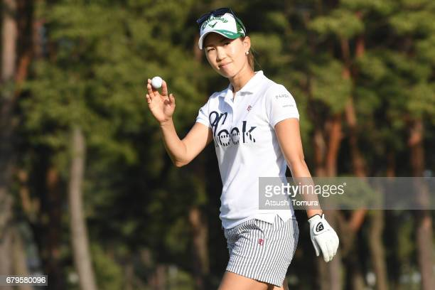 Momoko Ueda of Japan celebrates after chipping in her fourth shot on the 18th hole during the third round of the World Ladies Championship Salonpas...