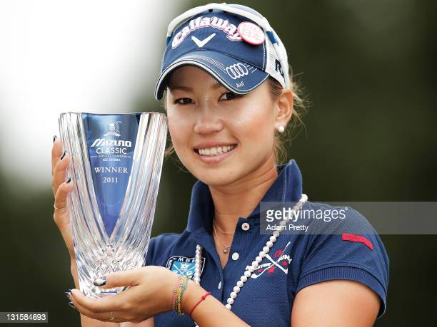 Momoko Ueda of Japan celebrates victory with the trophy after the 3rd playoff hole in the final round of the Mizuno Classic at Kintetsu Kashikojima...