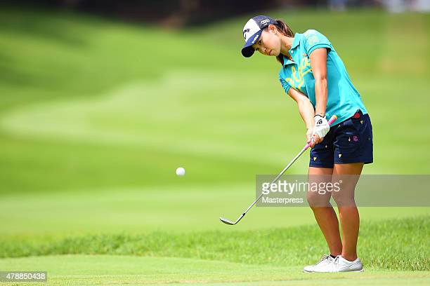 Momoko Ueda of Japan chips onto the 16th green during the final round of the Earth Mondamin Cup at the Camellia Hills Country Club on June 28 2015 in...