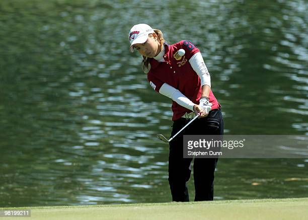Momoko Ueda of Japan chips onto the sixth green during the first round of the Kraft Nabisco Championship at Mission Hills Country Club on April 1...