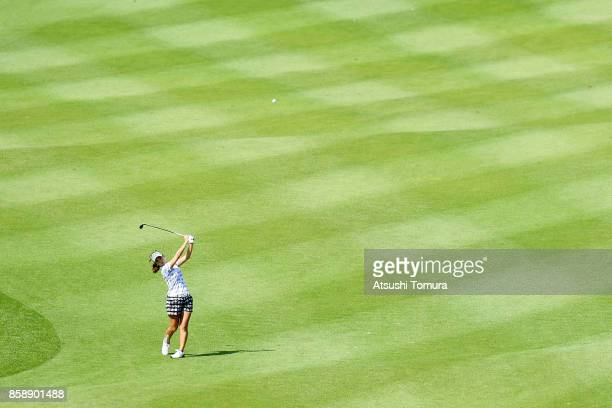 Momoko Ueda of Japan hits her second shot on the 8th hole during the final round of Stanley Ladies Golf Tournament at the Tomei Country Club on...