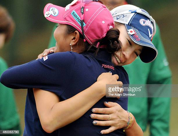 Momoko Ueda of Japan is congratulated by Ai Miyazato after winning the Mizuno Classic at Kintetsu Kashikojima Country Club on November 6 2011 in...
