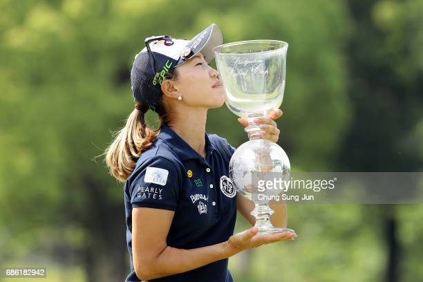 Momoko Ueda of Japan kisses the trophy during a ceremony following the Chukyo Television Bridgestone Ladies Open at the Chukyo Golf Club Ishino...