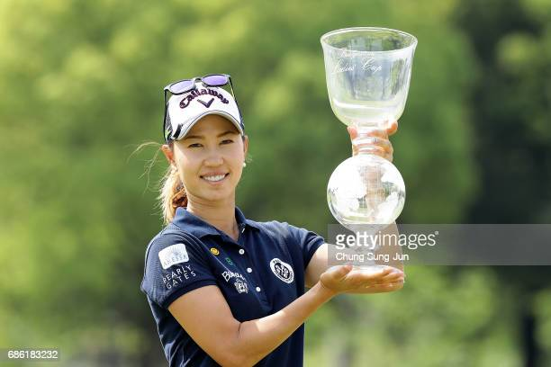 Momoko Ueda of Japan lifts the trophy during a ceremony following the Chukyo Television Bridgestone Ladies Open at the Chukyo Golf Club Ishino Course...
