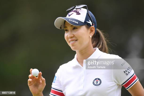 Momoko Ueda of Japan reacts after making her birdie putt on the 8th hole during the first round of the Suntory Ladies Open at the Rokko Kokusai Golf...